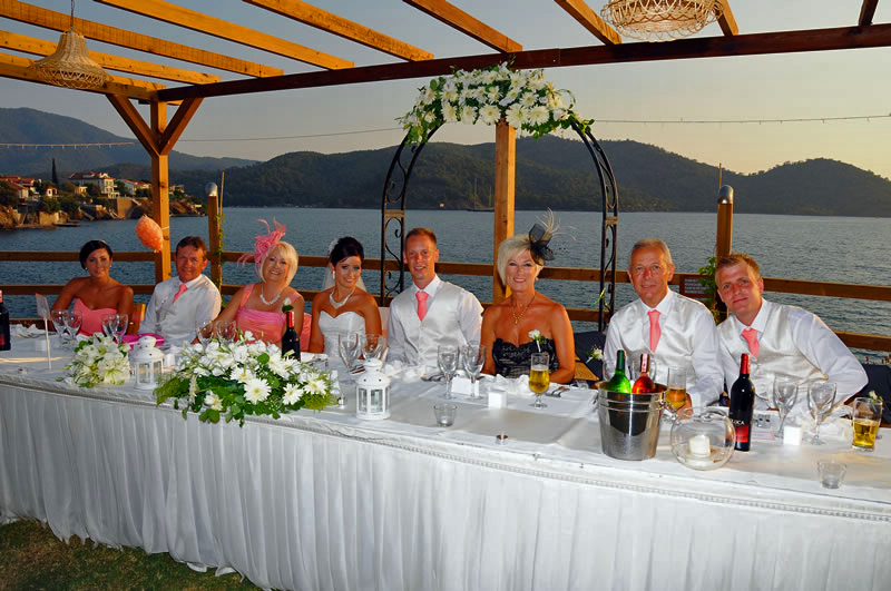 Guests enjoying a weddng meal on the garden terrace
