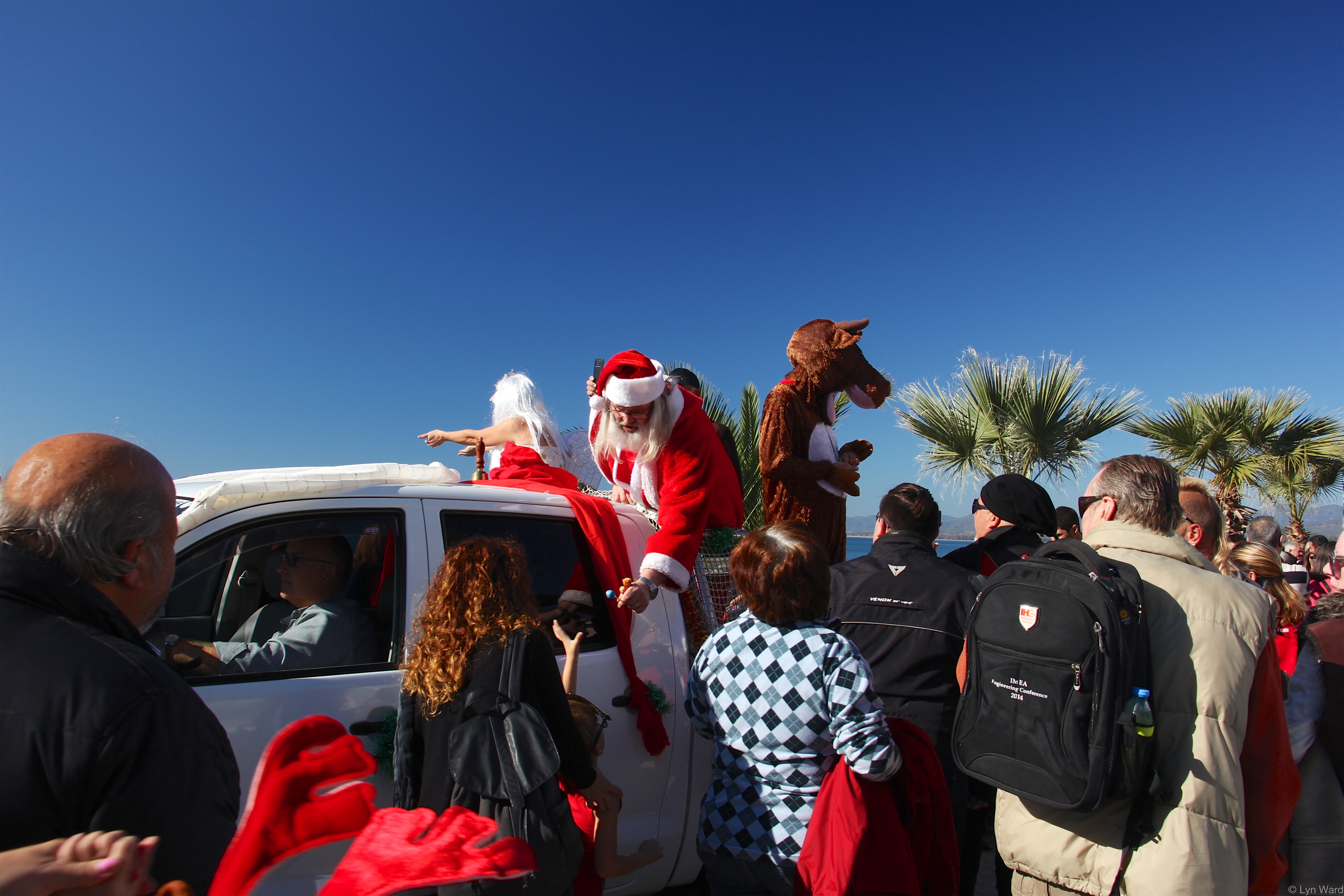 Santa handing out lollipops as he made his way to his Grotto