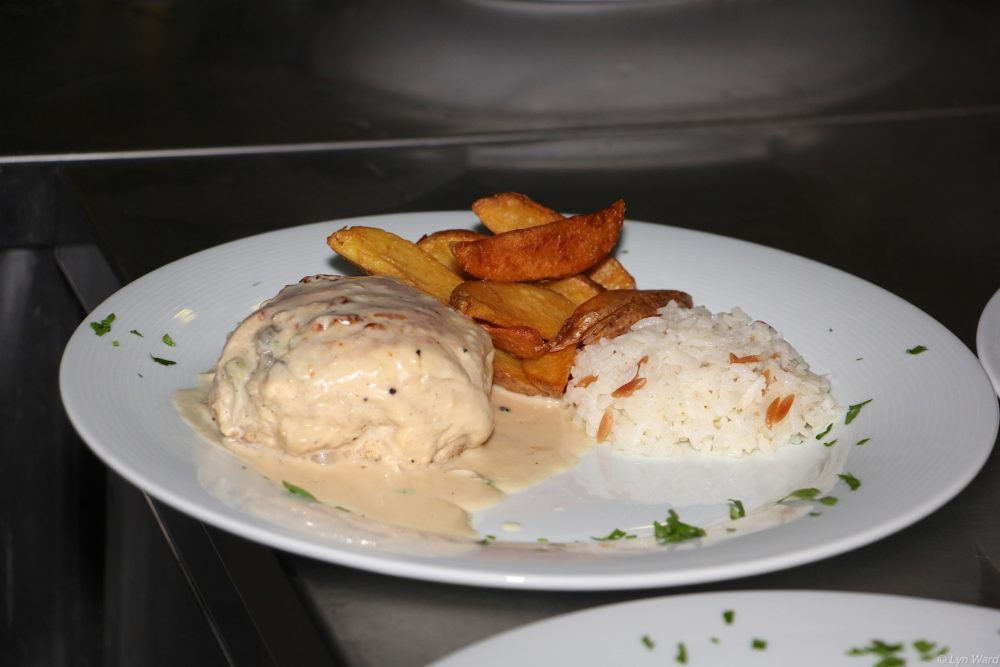Tavuk Dola (Stuffed Chicken) served with rice and chips