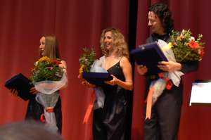 The trio including Cello player Özgür Elgün on the right receive the thanks of the organisors