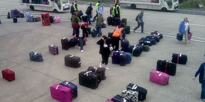 Passengers on Easyjet flight EZ6273 Bristol 31/03/2011 checking luggage before boarding the plane following a security check