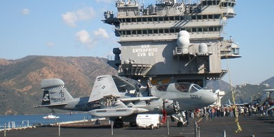 The flight deck of USS Enterprise with a FA18 Super Hornet. Crowds gathered for the tour of the ship too on its visit to Marmaris, Turkey