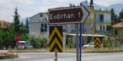 Road sign to Evdir Han, Antalya taken at speed.