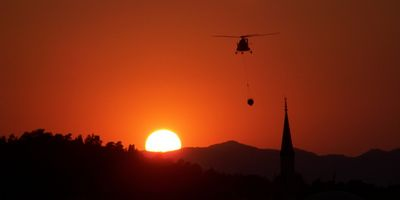 Fire control helicopter over Fethiye, Turkey at Sunset