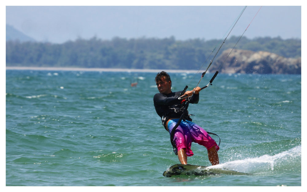 Kite Surfer skimming along the water