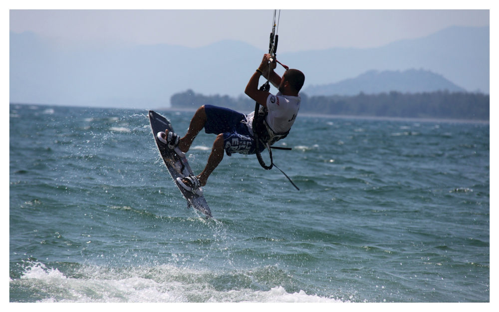 Kite Surfer performing some of his freestyle stunts
