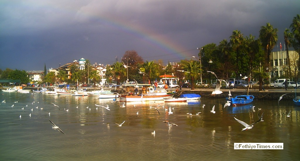 Fethiye harbour with rainbow in background after a shower