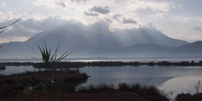 An autumn view of Fethiye from Calis bird sanctuary with the Mendos and Baba Dag mountians capped in cloud