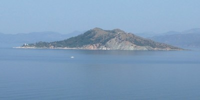 Red island in the gulf of Fethiye is a popular stopping off point for daily boat trips