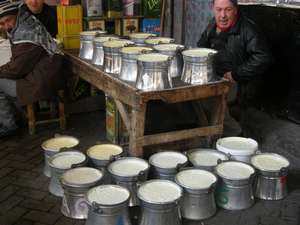 Diyarbakir in the market a yoghurt seller who still makes and sells his yoghurt in traditional tinned copper pots