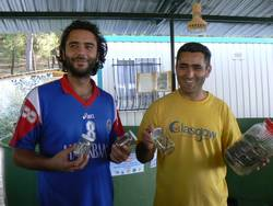 Dogan and Yakup show the fishing lines and hooks removed from Loggerhead Turtles brought to the centre