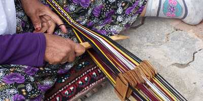 Traditional skill of creating braids by a Yoruk woman Fethiye April 2010