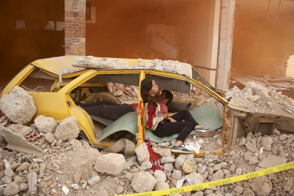 People trapped in cars crushed by falling rubble